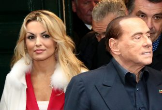 Head of the centre-right Forza Italia (Go Italy) Silvio Berlusconi (R) leaves with his companion Francesca Pascale (L) the San Severo chapel during his tour in downtown Naples on March 3, 2018 on the eve of a closely-watched general election poll. Rival parties held their final rallies on Friday, at the end of a bitter race marred by clashes between far-right and anti-fascist activists. / AFP PHOTO / Carlo Hermann        (Photo credit should read CARLO HERMANN/AFP via Getty Images)