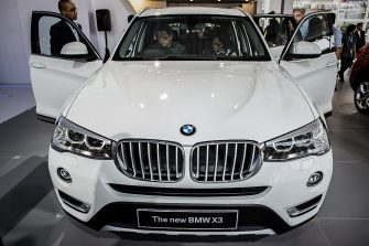 JAKARTA, INDONESIA - SEPTEMBER 03:  Visitors look inside the new BMW x3  at The 22st Indonesia International Motor Show (IIMS) 2014 on September 18, 2014 in Jakarta, Indonesia. The 22st IIMS features 36 automotive brands and more than 275 supporting industries. The theme this year is 'Smart & Safe Mobility', and the displays are made up primarily of environmentally-friendly, fuel-efficient and affordable vehicles. (Photo by Oscar Siagian/Getty Images)