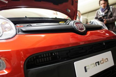 The new model of the Fiat Panda is presented on December 14, 2011 at the Fiat plan in Pomogliano D'Arco. Fiat boss Sergio Marchionne unveiled the new Panda model at the plant where workers have signed controversial new contracts to stop production moving to Poland. A latest deal adopted the day before and which affects all Fiat workers, signed by Fiat and all unions with the exception of the left-wing Fiom, includes increased overtime, cuts in breaks, an increase in night shifts and penalties for those who are absent without permission.  AFP PHOTO / Andrea Baldo (Photo credit should read Andrea Baldo/AFP via Getty Images)