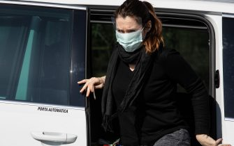 CASALPUSTERLENGO, ITALY - FEBRUARY 24:  A woman, wearing a respiratory mask, gets out of a taxi at a road block on February 24, 2020 in Casalpusterlengo, south-west Milan, Italy. Casalpusterlengo is one of the ten small towns placed under lockdown after coronavirus sparked infections throughout the Lombardy region. Italy is the last country to be hit hard by the virus with five dead and more than 224 infected as of today. The spread marks Europeâ  s biggest outbreak, prompting Italian Government to issue draconian safety measures. (Photo by Emanuele Cremaschi/Getty Images)