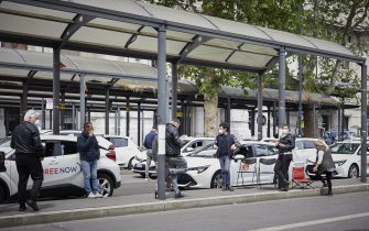 MILAN, ITALY - MAY 01:  Some taxi drivers waiting to pick up fares in front of Milan Central Station during Labor Day on May 01, 2020 in Milan, Italy. Italy will remain on lockdown to stem the transmission of the Coronavirus (Covid-19), slowly easing restrictions. (Photo by Lorenzo Palizzolo/Getty Images)