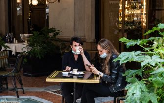 MILAN, ITALY - MAY 18: Two customers of the restaurant of the starred chef Carlo Cracco while sipping a coffee on the first day of opening after the lockdown on May 18, 2020 in Milan, Italy. Restaurants, bars, cafes, hairdressers and other shops have reopened, subject to social distancing measures, after more than two months of a nationwide lockdown meant to curb the spread of Covid-19. (Photo by Roberto Finizio/Getty Images)