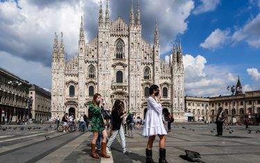 Young woman walk across Piazza del Duomo and the cathedral on June 3, 2020 in downtown Milan, as the country eases its lockdown aimed at curbing the spread of the COVID-19 infection, caused by the novel coronavirus. (Photo by Miguel MEDINA / AFP) (Photo by MIGUEL MEDINA/AFP via Getty Images)