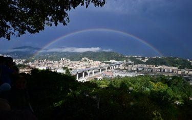 A rainbow is seen over the new San Giorgio bridge on the inauguration day on August 3 , 2020 in Genoa, the new high-tech structure will have four maintenance robots running along its length to spot weathering or erosion, as well as a special dehumidification system to limit corrosion. - Italy inaugurates a sleek new bridge in Genoa, though relatives of the 43 people killed when the old viaduct collapsed say the pomp and ceremony risk overshadowing the tragedy. (Photo by MIGUEL MEDINA / AFP) (Photo by MIGUEL MEDINA/AFP via Getty Images)