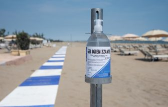 VENICE, ITALY - MAY 23: A bottle of sanitizing gel is set up as beaches reopen in Lido on May 23, 2020 in Venice, Italy. Restaurants, bars, cafes, hairdressers and other shops have reopened, subject to social distancing measures, after more than two months of a nationwide lockdown meant to curb the spread of COVID-19. (Photo by Simone Padovani/Awakening/Getty Images)
