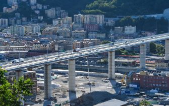 Vehicles drive across the new San Giorgio bridge, following its reopening for traffic, in Genoa, northern Italy on August 5, 2020. - The gleaming new bridge in Genoa built after the deadly collapse of a viaduct opened on August 4, but critics say not enough has been done since the 2018 disaster to overhaul Italy's crumbling infrastructure. (Photo by ANDREAS SOLARO / AFP) (Photo by ANDREAS SOLARO/AFP via Getty Images)