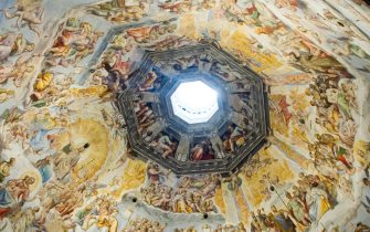 FLORENCE, ITALY - AUGUST 14: Vasari's frescoes adorn Brunelleschi's dome of Florence Cathedral or Basilica of Saint Mary of the Flower (in italian Il Duomo di Firenze or Basilica di Santa Maria del Fiore) on August 14, 2012, in Florence, Tuscany, Italy. Florence, the capital city of Tuscany, is famous for its history: a centre of medieval European trade and finance and one of the wealthiest cities of the time, it is considered the birthplace of the Renaissance. Tuscany is a region in central Italy known for its landscapes, traditions, history, artistic legacy and its influence on high culture, making it a popular tourist destination that attracts millions of tourists every year. (Photo by Lucas Schifres/Getty Images)
