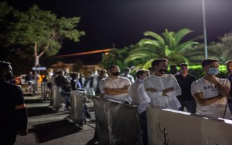 """RIMINI, ITALY - JUNE 20: People wait to enter the club at the opening of the summer season for """"Villa delle Rose"""", one of the most famous clubs on the Adriatic Coast on June 20, 2020 in Rimini, Italy. The Villa delle Rose is among the first dance clubs to reopen in the Adriatic Riviera after the Covid-19 pandemic. (Photo by Max Cavallari/Getty Images)"""