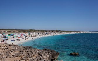 SARDINIA, ITALY - JULY 09:  View of Is Arutas beach on July 09, 2013 in Province of Oristano, Italy.  (Photo by Massimo Di Nonno/Getty Images)