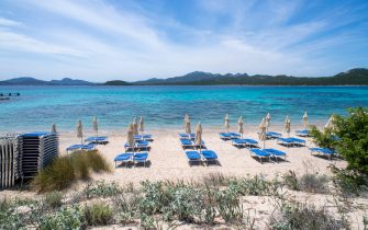PORTO CERVO, ITALY - MAY 24: A view of a beach with umbrellas and sunbeds still closed on May 24, 2020 in Porto Cervo, Sardinia, Italy. Restaurants, bars, cafes, hairdressers and other shops have reopened, subject to social distancing measures, after more than two months of a nationwide lockdown meant to curb the spread of Covid-19. (Photo by Emanuele Perrone/Getty Images)