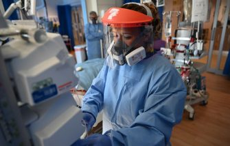 Members of the clinical staff wear personal protective equipment (PPE) as they care for patients at the Intensive Care unit at Royal Papworth Hospital in Cambridge, on May 5, 2020. - NHS staff wear an enhanced level of PPE in higher risk areas such as critical care to minimise the spread of infection between staff and patients. Britain's death toll from the novel coronavirus COVID-19 has topped 32,000, according to an updated official count released Tuesday, pushing the country past Italy to become the second-most impacted after the United States. (Photo by Neil HALL / POOL / AFP) (Photo by NEIL HALL/POOL/AFP via Getty Images)