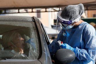 Health workers wearing personal protective equipment (PPE) and protective masks perform swab tests at the port of Civitavecchia, near Rome, Italy, 22 August 2020. ANSA/GIUSEPPE LAMI