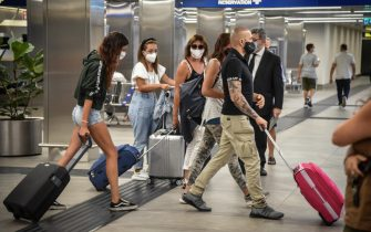 Passengers on the Iberia flight from Madrid arrive at Linate airport in Milan, Italy, August 17, 2020. Lombardy Region government is working to set up nearby at the Linate and Malpensa airports, by the middle of the next week, swab stations also involving facilities hospital.Ansa / Matteo Corner