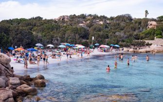 PORTO CERVO, ITALY - AUGUST 18: A view of a beach in Porto Cervo full of tourists in this week of August. Many Italians have chosen Italian tourist locations to spend their summer holidays on August 18, 2020 in Porto Cervo, Italy. (Photo by Emanuele Perrone/Getty Images)
