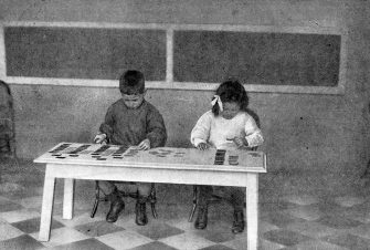 Montessori teaching method - early 20th century. Children working with language cards (placing articles and nouns together). Educational approach developed by Italian physician and educator Maria Montessori. 1870Â 1952.  (Photo by Culture Club/Getty Images) *** Local Caption ***