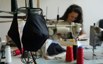 """BERLIN, GERMANY - APRIL 02: Master tailor Ala Hadye sews protective face masks in her workshop on April 02, 2020 in Berlin, Germany. Hadye, who has had to close her shop due to nationwide measures enacted to slow the spread of the coronavirus, says she is making 30 to 40 masks per week on custom order from her customers. """"I could be making masks all week,"""" she said, but says she turns large orders down and concentrates instead on her core customers. """"There are so many others making masks"""", she says of other tailors she knows. Since her shop is closed she sends the masks to her customers by post rather than having them come to the shop. (Photo by Sean Gallup/Getty Images)"""