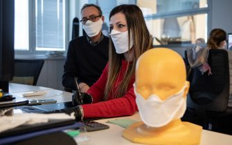 VERANO BRIANZA, ITALY - MARCH 25: Two designers use a CAD software to design a protective face mask at Cifra production plant on March 25, 2020 in Verano Brianza, near Milan, Italy. Cifra is a manufacturing company producing garments for leading global fashion brands. Following the novel Coronavirus outbreak in Italy, Cifra has converted its industrial activities to patent and produce a high-tech, double layered and water-repellent protective face mask for civil use, called WARP-MASK. (Photo by Emanuele Cremaschi/Getty Images)