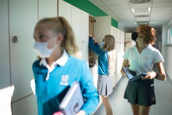 TURIN, ITALY - SEPTEMBER 01: Pupils wear protective masks take school supplies from inside the lockers of the WINS World International School Turin on September 01, 2020 in Turin, Italy. In Italy, the first day of school after the Covid-19 pandemic takes place with a private school that began classes today September 1, 2020. The Italian Ministry of Education has indicated the opening of state schools on September 14, 2020. (Photo by Stefano Guidi/Getty Images)