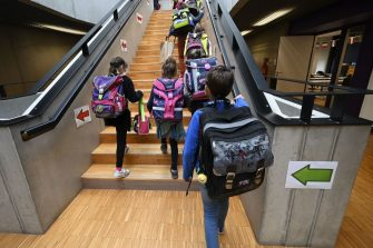 Pupils walk upstairs to go to their classroom at the Europeen school of Strasbourg, eastern France, on September 1, 2020 at the start of the new school year amid the Covid-19 epidemic. - French pupils go back to school on September 1 as schools across Europe open their doors to greet returning pupils this month, nearly six months after the coronavirus outbreak forced them to close and despite rising infection rates across the continent. (Photo by FREDERICK FLORIN / AFP) (Photo by FREDERICK FLORIN/AFP via Getty Images)