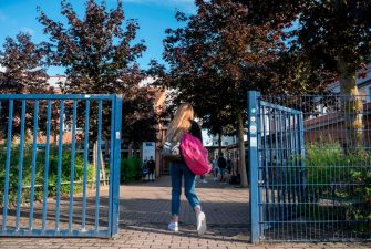 A student heads into the Christophorusschule school in Rostock, northern Germany, on August 3, 2020, as school resumed after the summer break in the German state of Mecklenburg-Vorpommern (Mecklenburg-Western Pomerania), amid a Coronavirus Covid-19 pandemic. -  (Photo by John MACDOUGALL / AFP) (Photo by JOHN MACDOUGALL/AFP via Getty Images)