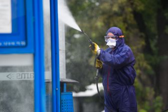 KRAKOW, POLAND - SEPTEMBER 03: An employee from Krakow Municipality wearing a protective suit, gloves and goggles cleans and disinfects a public transport stop on September 03, 2020 in Krakow, Poland. Poland has banned flights from 44 countries and has reintroduced restrictions on public life in the worst affected parts of the country, in order to prevent the spread of Coronavirus. Poland, a country of 38 million, has officially  registered 67,922 COVID-19 infections and more than 2,000 deaths from the virus. (Photo by Omar Marques/Getty Images)