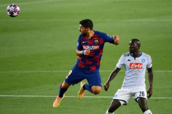 Barcelona's Uruguayan forward Luis Suarez (L) eyes the ball as he vies for it with Napoli's Senegalese defender Kalidou Koulibaly during the UEFA Champions League round of 16 second leg football match between FC Barcelona and Napoli at the Camp Nou stadium in Barcelona on August 8, 2020. (Photo by LLUIS GENE / AFP) (Photo by LLUIS GENE/AFP via Getty Images)