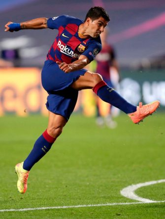 Barcelona's Uruguayan forward Luis Suarez jumps during the UEFA Champions League quarter-final football match between Barcelona and Bayern Munich at the Luz stadium in Lisbon on August 14, 2020. (Photo by Manu Fernandez / POOL / AFP) (Photo by MANU FERNANDEZ/POOL/AFP via Getty Images)