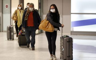 PARIS, FRANCE - FEBRUARY 10: Passengers coming from China wearing protective masks leave the Terminal after landing in Charles De Gaulle Airport on February 10, 2020 in Roissy-en-France. The Coronavirus was first detected in December in Wuhan, the capital of Hubei province, and has left at least 908 dead in mainland China, where the number of infected people exceeds 40,000, according to today's report by the Chinese authorities. The epidemic is spreading worldwide with confirmed cases in more than 25 countries and territories. (Photo by Chesnot/Getty Images)