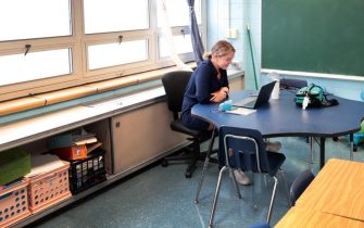 CHICAGO, ILLINOIS - SEPTEMBER 08: Lucy Baldwin, a teacher at King Elementary School, sits in an empty classroom teaching her students remotely during the first day of classes on September 08, 2020 in Chicago, Illinois. Students at King Elementary and the rest of Chicago public schools started classes today with students being taught remotely because of COVID-19 concerns. Teachers are given the option to teach from home or from their classrooms.  (Photo by Scott Olson/Getty Images)