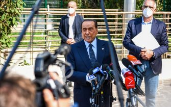 Former Italian prime minister Silvio Berlusconi addresses the media, as he leaves the San Raffaele Hospital in Milan on September 14, 2020 after he tested posititive for coronavirus and was hospitalized since September 3. (Photo by Piero CRUCIATTI / AFP) (Photo by PIERO CRUCIATTI/AFP via Getty Images)