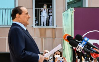 Medical staff take photos of Former Italian prime minister Silvio Berlusconi as he addresses the media, as he leaves the San Raffaele Hospital in Milan on September 14, 2020 after he tested posititive for coronavirus and was hospitalized since September 3. (Photo by Piero CRUCIATTI / AFP) (Photo by PIERO CRUCIATTI/AFP via Getty Images)