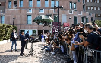 Former Italian prime minister Silvio Berlusconi (Front L) addresses the media, as he leaves the San Raffaele Hospital in Milan on September 14, 2020 after he tested posititive for coronavirus and was hospitalized since September 3. (Photo by Piero CRUCIATTI / AFP) (Photo by PIERO CRUCIATTI/AFP via Getty Images)
