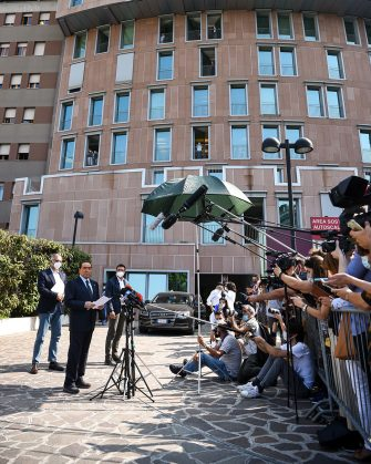 Former Italian prime minister Silvio Berlusconi (Front L) addresses the media as he leaves the San Raffaele Hospital in Milan on September 14, 2020 after he tested posititive for coronavirus and was hospitalized since September 3. (Photo by Piero CRUCIATTI / AFP) (Photo by PIERO CRUCIATTI/AFP via Getty Images)