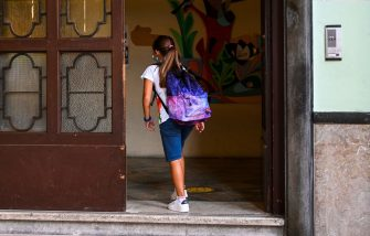 A pupil wearing a face mask arrives on September 14, 2020 for the start of the school year at the Luigi Einaudi technical high school in Rome, during the the COVID-19 infection, caused by the novel coronavirus. - Schools in some European nations were set to open on September 14, 2020 with millions returning to classrooms in Italy, Greece and Romania. (Photo by Vincenzo PINTO / AFP) (Photo by VINCENZO PINTO/AFP via Getty Images)