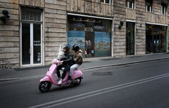 A scooter rides across Via Tomacelli in central Rome on March 12, 2020, as Italy shut all stores except for pharmacies and food shops in a desperate bid to halt the spread of a coronavirus. (Photo by Alberto PIZZOLI / AFP) (Photo by ALBERTO PIZZOLI/AFP via Getty Images)