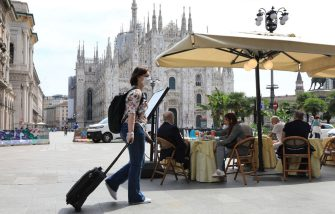 MILAN, ITALY - MAY 18:  People have drinks and food at a restaurant on Piazza del Duomo on the first day of opening after the lockdown on May 18, 2020 in Milan, Italy. Restaurants, bars, cafes, hairdressers and other shops have reopened, subject to social distancing measures, after more than two months of a nationwide lockdown meant to curb the spread of Covid-19. (Photo by Vincenzo Lombardo/Getty Images)