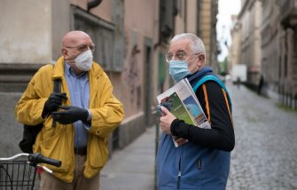 TURIN, ITALY - MAY 29: Two elderly wearing a protective mask talk to each other on May 29, 2020 in Turin, Italy. The Piedmont Region in complete autonomy declared that from today 29 May it is mandatory to use the protective mask even outdoors to prevent further infections from Coronavirus (Covid 19). Many Italian businesses have been allowed to reopen, after more than two months of a nationwide lockdown meant to curb the spread of Covid-19. (Photo by Stefano Guidi/Getty Images)