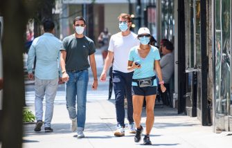 NEW YORK, NEW YORK - JULY 22: People wear protective face masks on the Upper East Side as the city enters Phase 4 of re-opening following restrictions imposed to slow the spread of coronavirus on July 22, 2020 in New York City. The fourth phase allows outdoor arts and entertainment, sporting events without fans and media production. (Photo by Noam Galai/Getty Images)