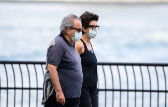 NEW YORK, NEW YORK - JULY 23:  People wear protective face masks while walking at the East River Esplanade in Murray Hill as the city enters Phase 4 of re-opening following restrictions imposed to slow the spread of coronavirus on July 23, 2020 in New York City. The fourth phase allows outdoor arts and entertainment, sporting events without fans and media production. (Photo by Noam Galai/Getty Images)