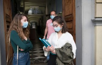 TURIN, ITALY - JUNE 17: Girls wearing protective masks await entry to the classroom for their High School Graduation Exams outside the Liceo Classico Massimo D'Azeglio on June 17, 2020 in Turin, Italy. High School Graduation Exams starting today with a change in the traditional process as Covid-19 pandemic forced the teachers to have an oral examination. (Photo by Stefano Guidi/Getty Images)