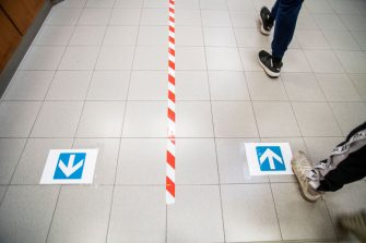 TURIN, ITALY - SEPTEMBER 15: Signs of direction are seen on the school floor on September 15, 2020 in Turin, Italy. There is a new path to follow and signs are everywhere. Italian children returned to the classroom as most schools reopened six months after they closed to curb the ongoing Coronavirus pandemic. Italy was one of the first in Europe to be hit by the pandemic, with 35,500 deaths out of a total of 280,000 cases.  (Photo by Diana Bagnoli/Getty Images)