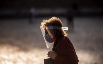 ROME, ITALY - OCTOBER 07: A pedestrian wearing a protective mask walks at Piazza del Popolo amid Covid-19 pandemic, on October 07, 2020 in Rome, Italy. Today Italian Prime Minister Giuseppe Conte set an order to make the wearing of face masks in outdoor spaces mandatory due to the increase of Covid-19 cases in Italy. Today there has been an increase in new COVID-19 cases in Italy with the number rising to 3678 for the first time in months. (Photo by Antonio Masiello/Getty Images)