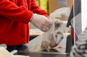 ROME, ITALY - MAY 06: A Cashier at a supermarket works while wearing a gloves as a preventive measure during the Coronavirus (COVID-19) crisis on May 06, 2020 in Rome, Italy. Italy was the first country to impose a nationwide lockdown to stem the transmission of the Coronavirus (Covid-19), and its restaurants, theaters and many other businesses remain closed. (Photo by Silvia Lore/Getty Images)