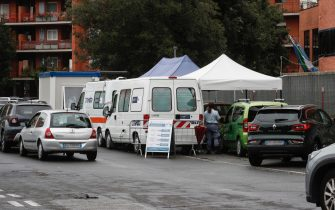 Motorists wait in line for their swab samples to be taken for COVID-19 testing by health workers at the drive-in of the 'Casa della Salute' of the ASL Roma 1 health facilities in the Labaro district, Rome, Italy, 7 October 2020. ANSA/GIUSEPPE LAMI