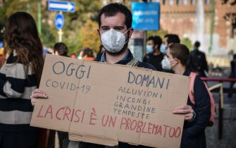 Supporters of school strike movement Fridays For Future demonstrate during the global climate action day in Castello square in Milan, Italy,  09 October 2020  Ansa/Matteo Corner