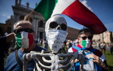 La manifestazione dei contrari alla mascherina a Piazza San Giovanni  Roma,10 ottobre settembre 2020 ANSA/MASSIMO PERCOSSI