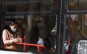 People aboard a bus wear protective face masks in Rome, Italy, 08 October 2020.  The Italian cabinet met to extend Italy's COVID-19 state of emergency until 31 January and approved a decree with new measures to combat the spread of the coronavirus.  ANSA / ETTORE FERRARI
