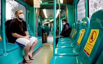 A tram with space signage during the Coronavirus emergency, in Milan, 27 April 2020.   ANSA/Mourad Balti Touati