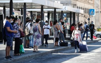 People wait a bus outside the Termini railway station during Phase 3 of the emergency for COVID-19 Coronavirus, Rome, Italy, 24 August 2020. ANSA/GIUSEPPE LAMI