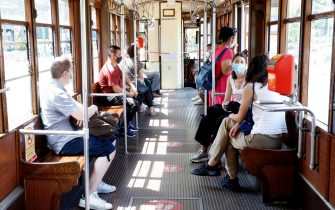 Passengers wearing face masks travel with the tram in Milan, northern Italy, during phase 3 of the Covid-19 emergency, 01 August 2020. ANSA/ MOURAD BALTI TOUATI